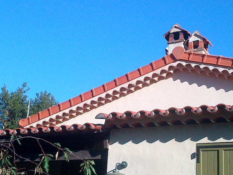 Exemple de réalisation de toiture et cheminée